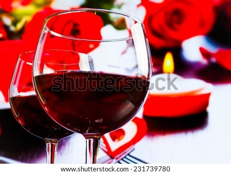two red wine glasses on blur hearts and roses decoration background, festive and love concept - stock photo