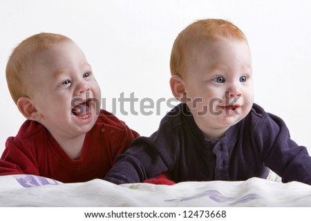 Two redhead twin boys smiling and laughing