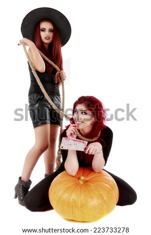 two redheads women with bloody hands halloween scene