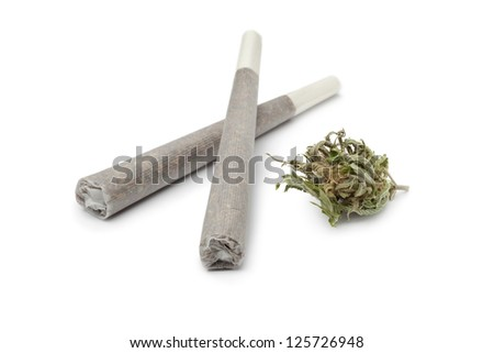 Two reefers with a Marijuana bud on white background - stock photo