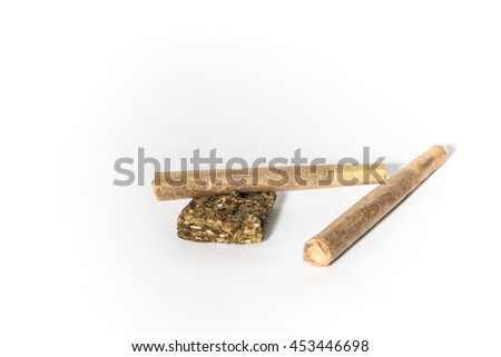 Two reefers with a Marijuana bud on white background