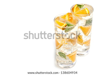 two refreshing cocktails on a white background - stock photo