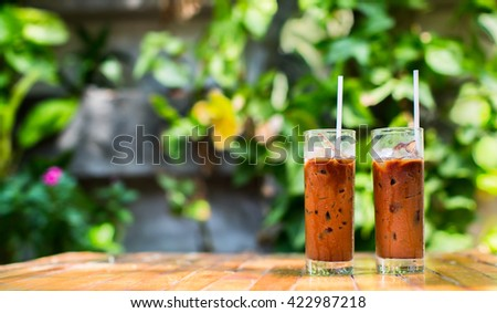 Two refreshing iced coffees in a garden cafe on a beautiful summer day. - stock photo