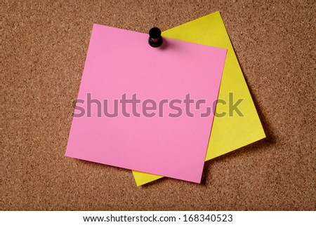 two reminders sticky note on cork board, empty space for text