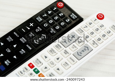 Two remote control devices on table