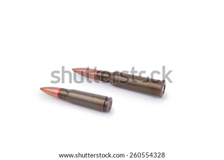Two rifle bullets over white background - stock photo