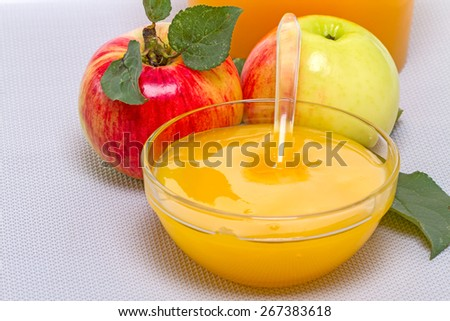 Two ripe apple and a bowl with honey - stock photo