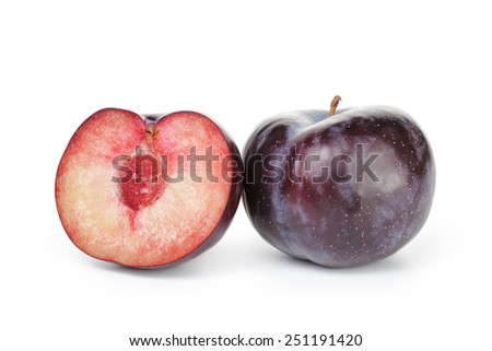 two ripe black plums isolated - stock photo