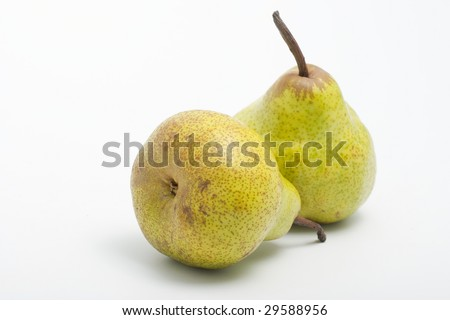 Two ripe juicy pears on a light background