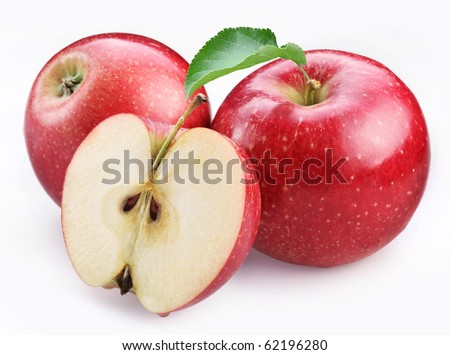 Two ripe red apples and half of apple. Isolated on a white background. - stock photo