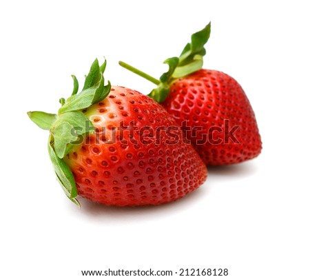 Two ripe strawberry fruit on white - stock photo