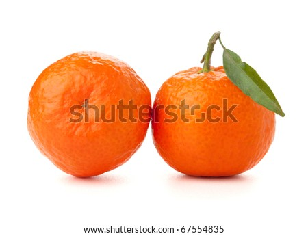 Two ripe tangerines with leafs. Isolated on white - stock photo