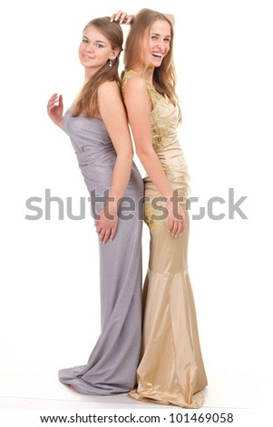 Two rival girls in gold and silver dress on a white background - stock photo