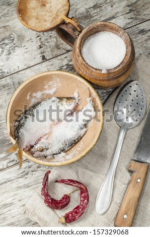 "Two roaches fish in ceramic bowl with salt., near the old cutlery. From the series ""Still Life with fresh fish"""