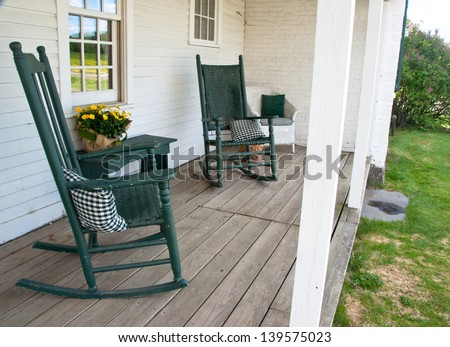 Two Rocking Chairs Invite One To Sit A While On This Old Porch