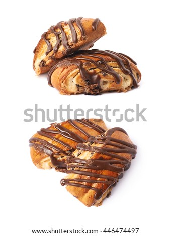 Two roll pastry buns covered with the chocolate, composition isolated over the white background, set of two different foreshortenings