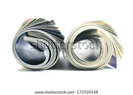 Two rolled up magazines on white background - stock photo