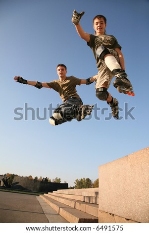 two rollers jump - stock photo
