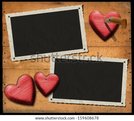 Two Romantic Photo Frames on Wood Wall / Two aged and romantic photo frames on wooden background with red hearts and folding knife - stock photo