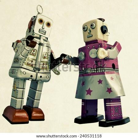 two romantic robots - stock photo