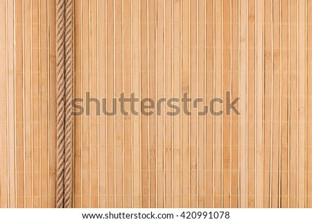 Two  rope lying on a bamboo mat, with a place for your text