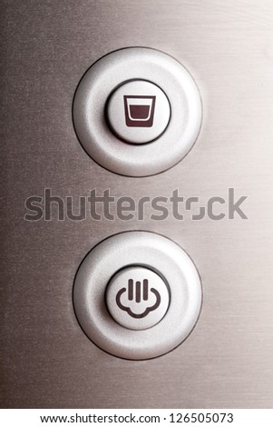 Two round buttons, coffee cup and steam