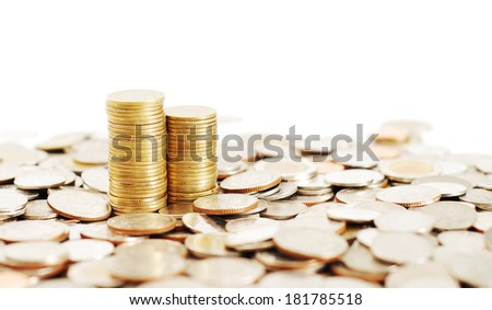 two row stack of coins on many coins background