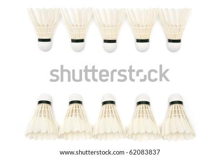two rows of badminton  shuttlecocks on white background - stock photo