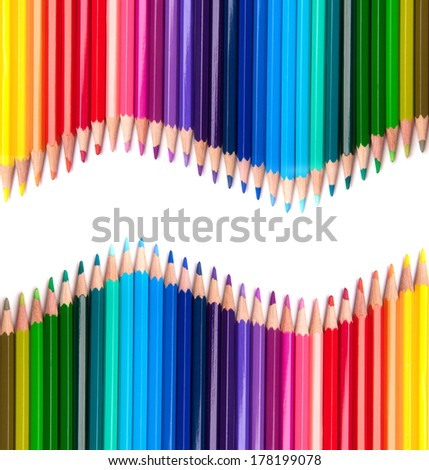 Two rows of colour drawing pencils, crayons - stock photo