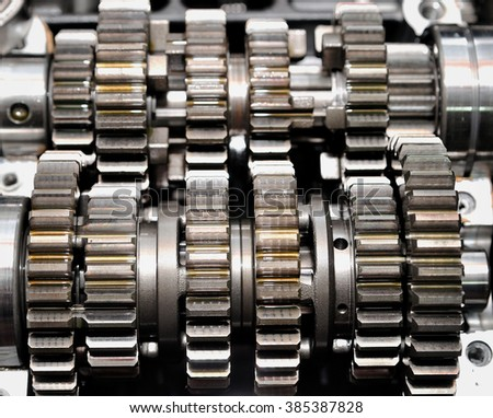 Two rows of gears with oil on it. - stock photo