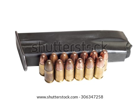 Two rows of 9mm shiny bullets and gun holder isolated on white background - stock photo