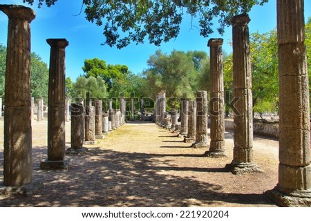 Two rows of stone pillars found in Greece, Olympia. - stock photo