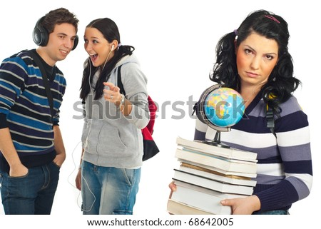 Two rude  students gossip and joke about their sad collegue female with stack of books and globe isolated on white background - stock photo