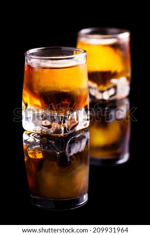 two rum shots with ice - stock photo