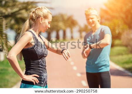 Two runners checked results of run distance - stock photo