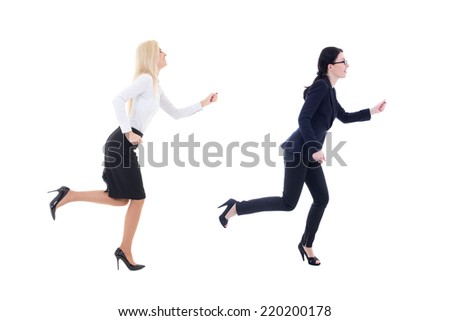 two running business women in business suit isolated on white background - stock photo
