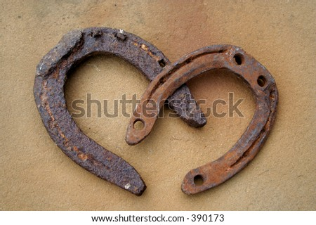 two rusty horseshoes - stock photo
