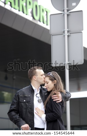 Two sad people at the airport  - stock photo