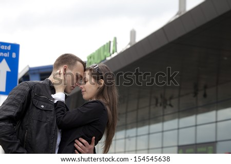 Two sad people say Goodbye at the airport  - stock photo