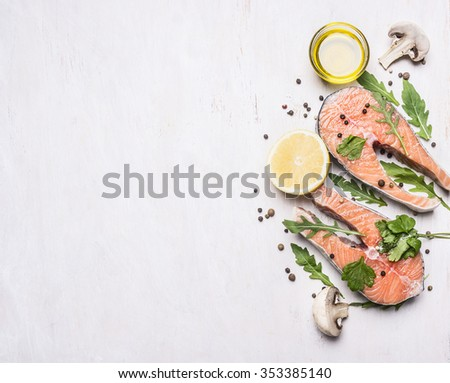 Two salmon steak, butter, pepper and salt, lemon, herbs border ,place for text  on wooden rustic background top view - stock photo