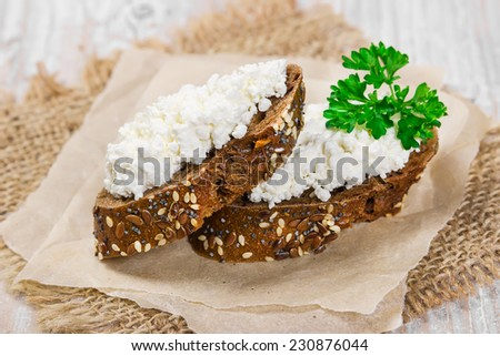 Two sandwich from rye bread with curd cheese and parsley. - stock photo