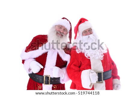 Two Santa Claus friends pose together. isolated on white with room for your text