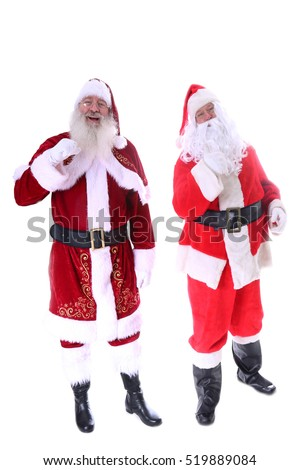 "Two Santa's pose and argue about who the ""Real Santa"" is. Isolated on white with room for your text. Old World Santa vs Modern Santa."