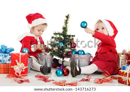 two santas girls decorating new year tree