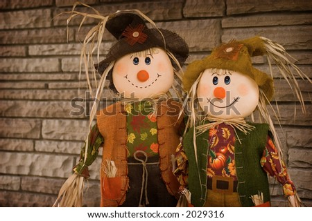 Two scarecrows. - stock photo