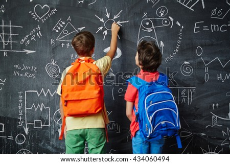 Two schoolboys studying at lesson - stock photo