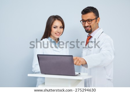 two science professionals working together on a project - stock photo