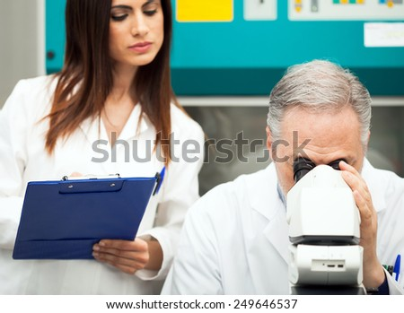 Two scientists at work in a laboratory