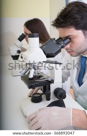 Two scientists conducting research in a lab