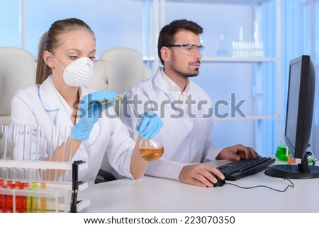 Two scientists conducting research in a lab environment - stock photo